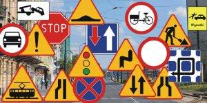 Znaki drogowe na tle miasta